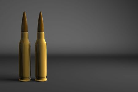 Two bullets on a dark gray background Stock Photo - 4720089