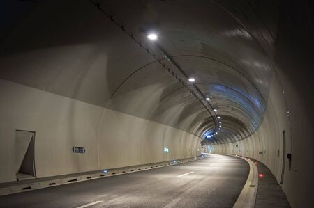 Empty highway tunnel in the evening photo