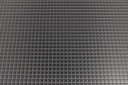 Abstract background made of a net of transparent gray cubes