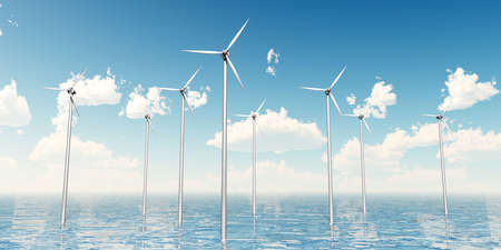 Wind turbines set on the sea, daylight, blue sky and clouds in the background Stock Photo