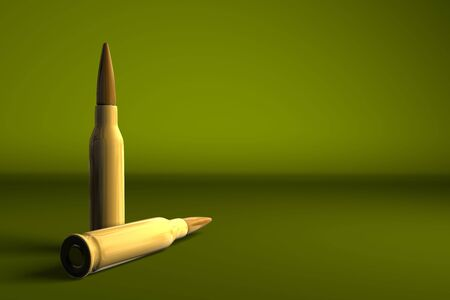 Two gun bullets on olive green background Stock Photo