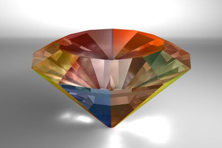 Colorful gem in a diamond shape on gray backdrop Stock Photo