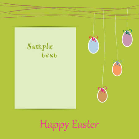spring motif with easter eggs and paper for text