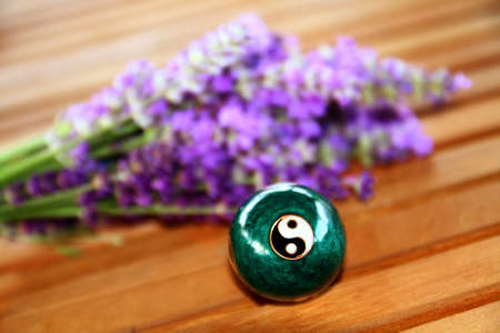 Green Chinese ball for relaxation. In the background is lavender. Stock Photo