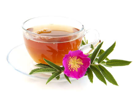 Cup of rose hip tea on a white background photo