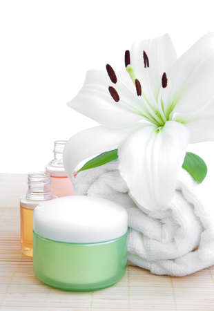 spa feeling (flower, towel, massage oil and cream) Stock Photo - 15403601