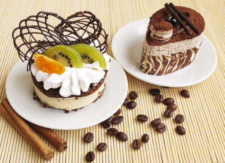 Chocolate Cake and cake with fruits on the table photo