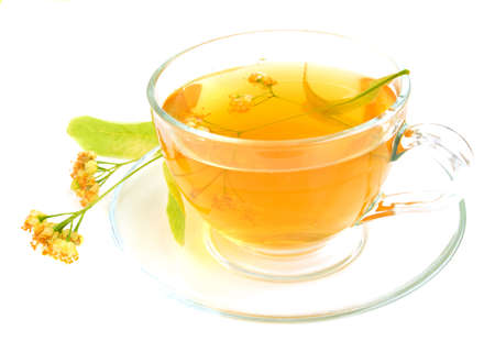 Sup of linden tea on a white background photo