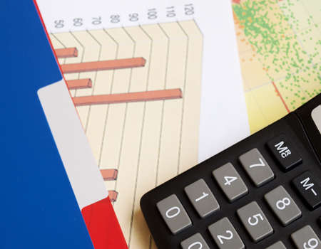 Business charts and graphs  and calculator Stock Photo - 15693945