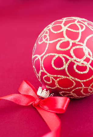 Christmas bauble on the red silk  background photo