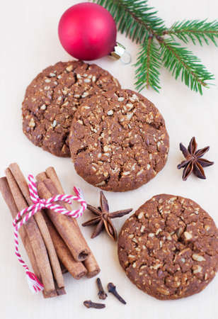 christmas cookies,nuts and spices on wooden table photo
