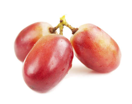 seedless: Red seedless grapes on a white background