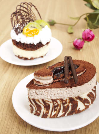 cheesecake: Chocolate Cake and cake with fruits onthe table