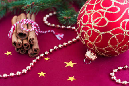 Christmas decoration with  cinnamon and Christmas bauble photo