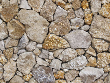 interstice: Fence of a natural building material of a yellow shell rock Stock Photo