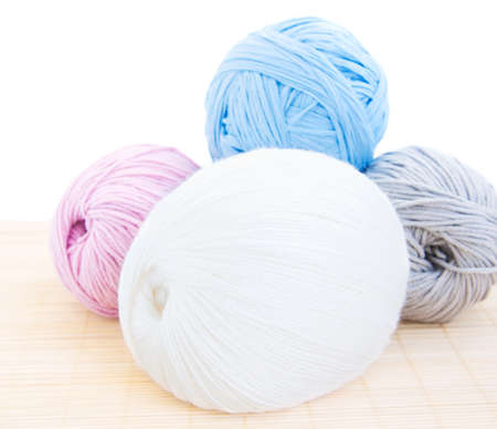 four yarn balls  on a white background photo