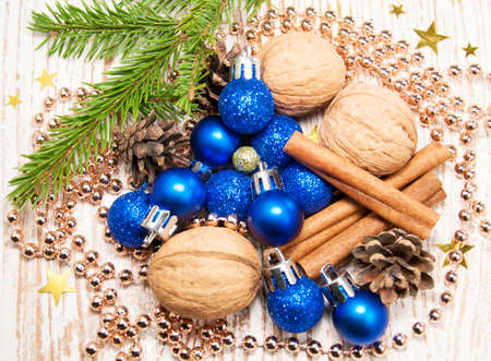 Blue christmas baubles on rustic wooden background photo