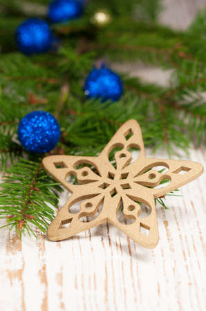 Christmas baubles on rustic wooden background photo