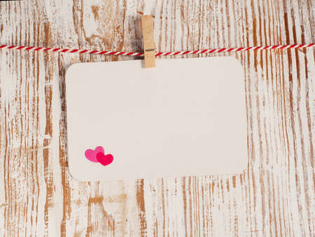 Card with  heart on wood, for your love message