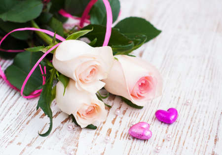 Pink Roses and hearts on a wooden background Stock Photo - 16959583