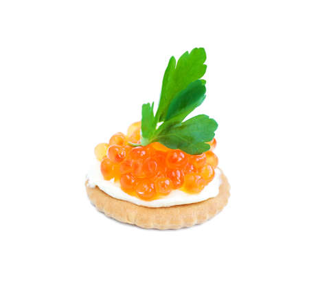 Canapes with  salmon red caviar on a white background photo