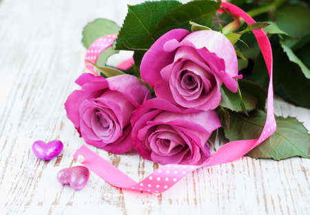 Pink Roses and hearts on a wooden background Stock Photo - 17117101