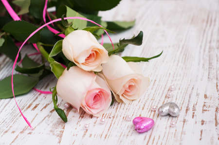 Pink Roses and hearts on a wooden background Stock Photo - 17179708