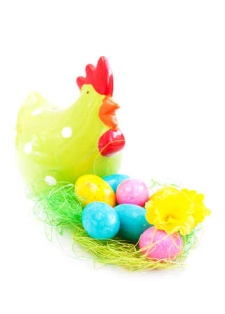 Colorful eggs in a traditional easter decoration nest Stock Photo - 18247430
