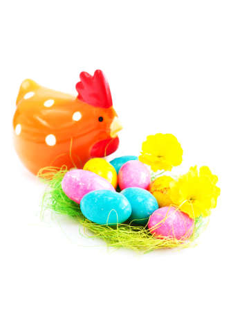 Colorful eggs in a traditional easter decoration nest Stock Photo - 18367408