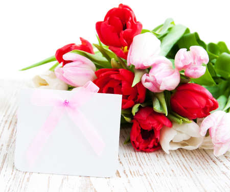 Bouquet of colorful Tulips with a blank note card photo