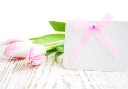 spring message: Blank card for spring, Easter, or Mothers Day with pink tulips Stock Photo