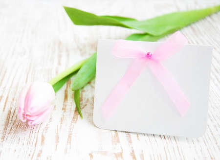 Blank card for spring, Easter, or Mothers Day with pink tulip photo