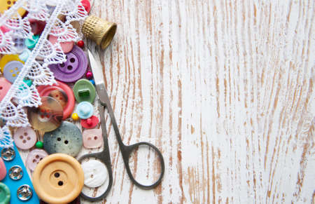 Sewing stuff on a old wood background Imagens