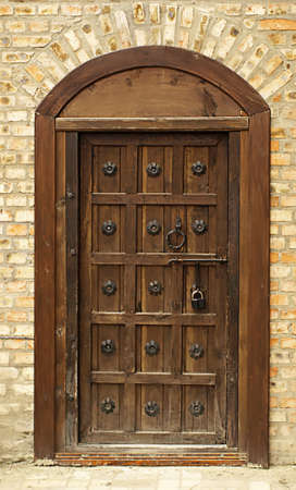 lovely old wooden door of a home       photo