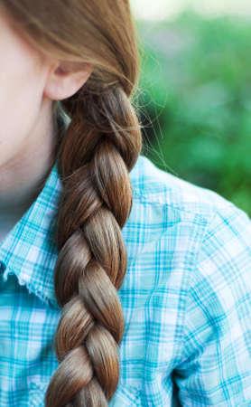 braided: Natural blonde braided hair. Close up.