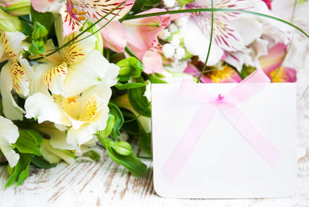 alstroemeria flowers with a white card for a message photo