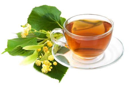 cup of tea and linden flowers on a white  background photo