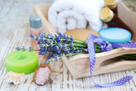 bathsalt: bottles of essential oil, candle, lavender and bath-salt