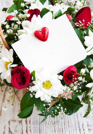 flowers with a white card for a message Stock Photo - 20945794