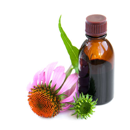Flowers and Echinacea tincture  on a white background photo