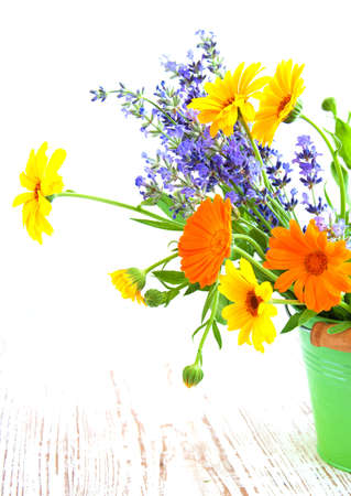 bouquet of calendula, daisy and lavender  flowers photo