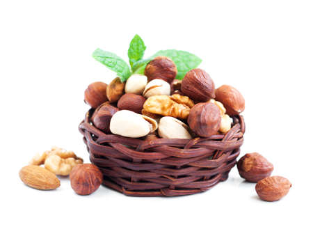 Basket with Mixed nuts on a white  background