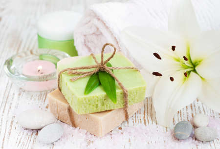 Spa setting with natural soaps and white lily  flower photo