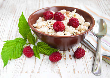 Fresh morning bowl of muesli and raspberries photo