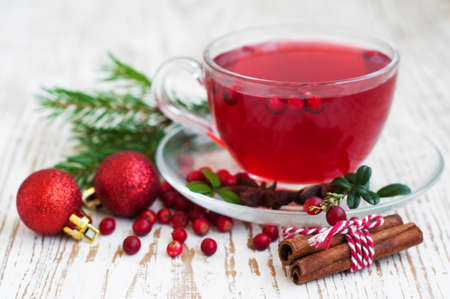 Hot winter drink with cranberries and cinnamon photo