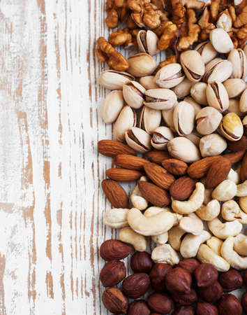 Mixed nuts on a old wooden background - Nuts  frame