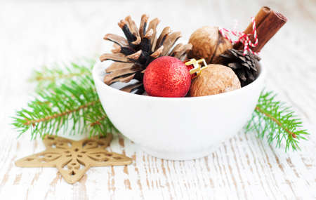Still life of a bowl of Christmas ornaments photo
