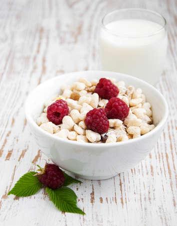 Fresh morning bowl of muesli and raspberries with milk photo