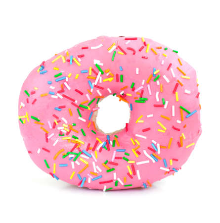 Pink Iced Doughnut covered in sprinkles on a white background photo