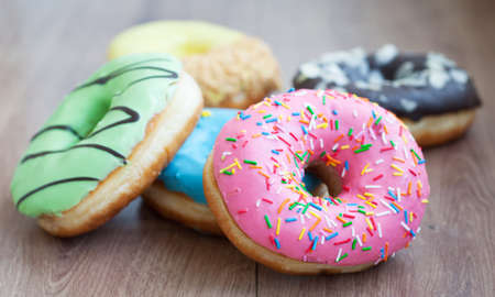 Donuts  on a wooden  Imagens